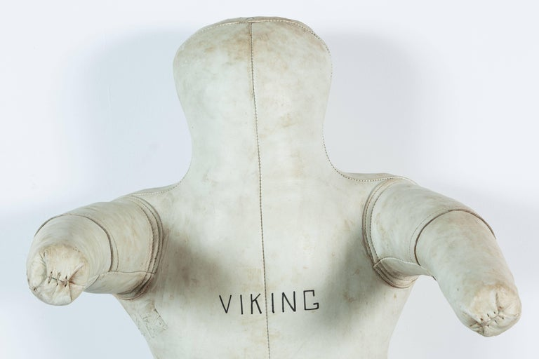 Great simple human form. Vintage Viking white leather gym wrestling dummy. This guy is solid. Nicely worn leather. Team Viking on front and makers identification on reverse.