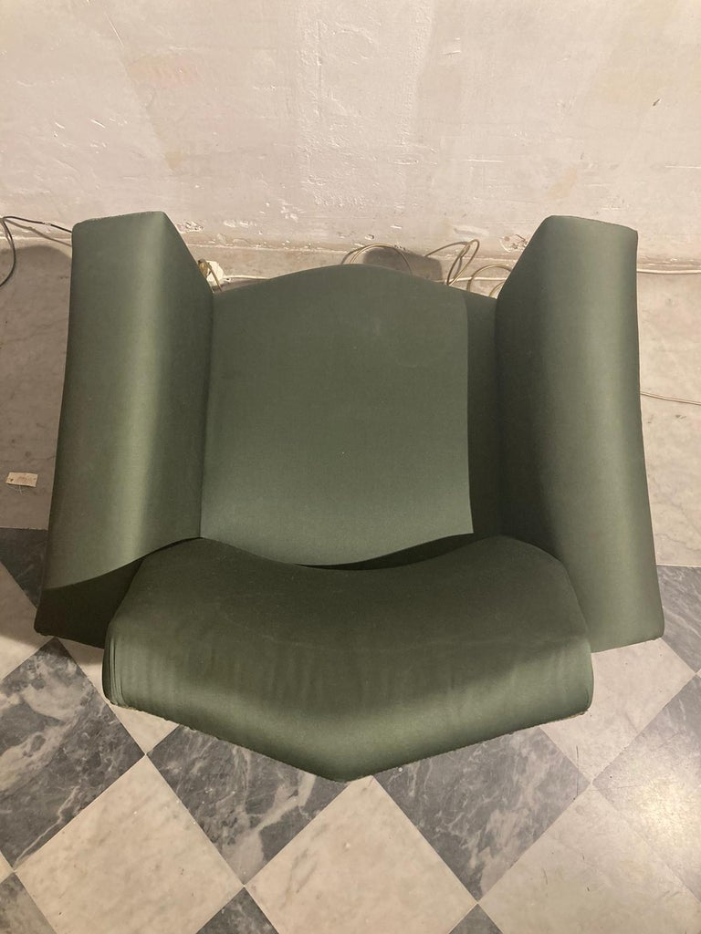 Lenci armchair is a midcentury design furniture manufactured in 1950s by Fabio Lenci.  Beautiful and vintage green silkcover armchair  Good conditions.  Very rare iconic armchair of great success and popularity.  Fabio Lenci was born in Rome