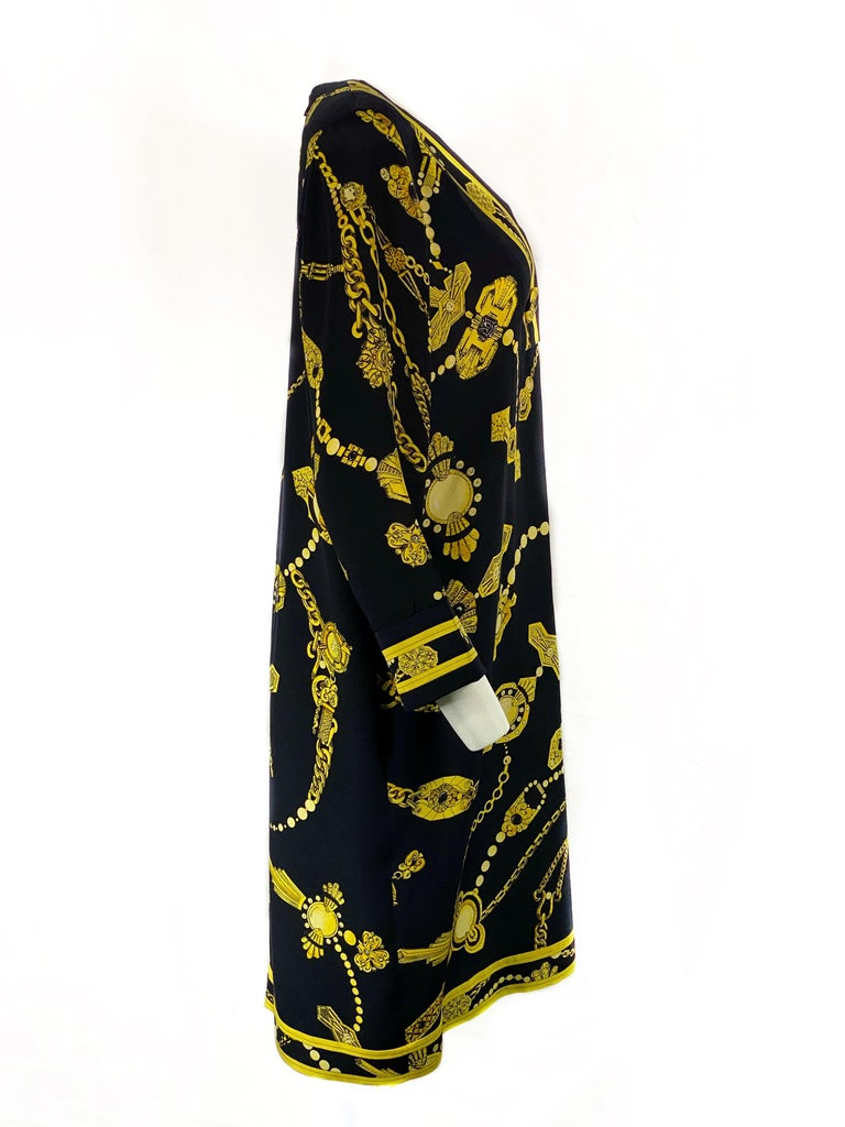 Vintage LEONARD Black and Yellow V- Neck Mini Dress   Product details: 100% Silk Black with yellow chain print and LEONARD stamps V- neck, measures 9 inches long with 3 large buttons detail, the diameter is 1.5 inches each  One pocket on each side