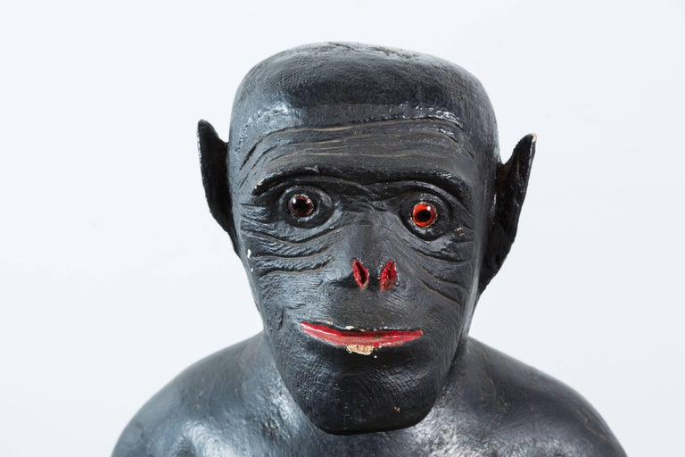 North American Vintage Life-Sized Folk Art Wood Monkey and Banana Carving with Glass Eyes For Sale
