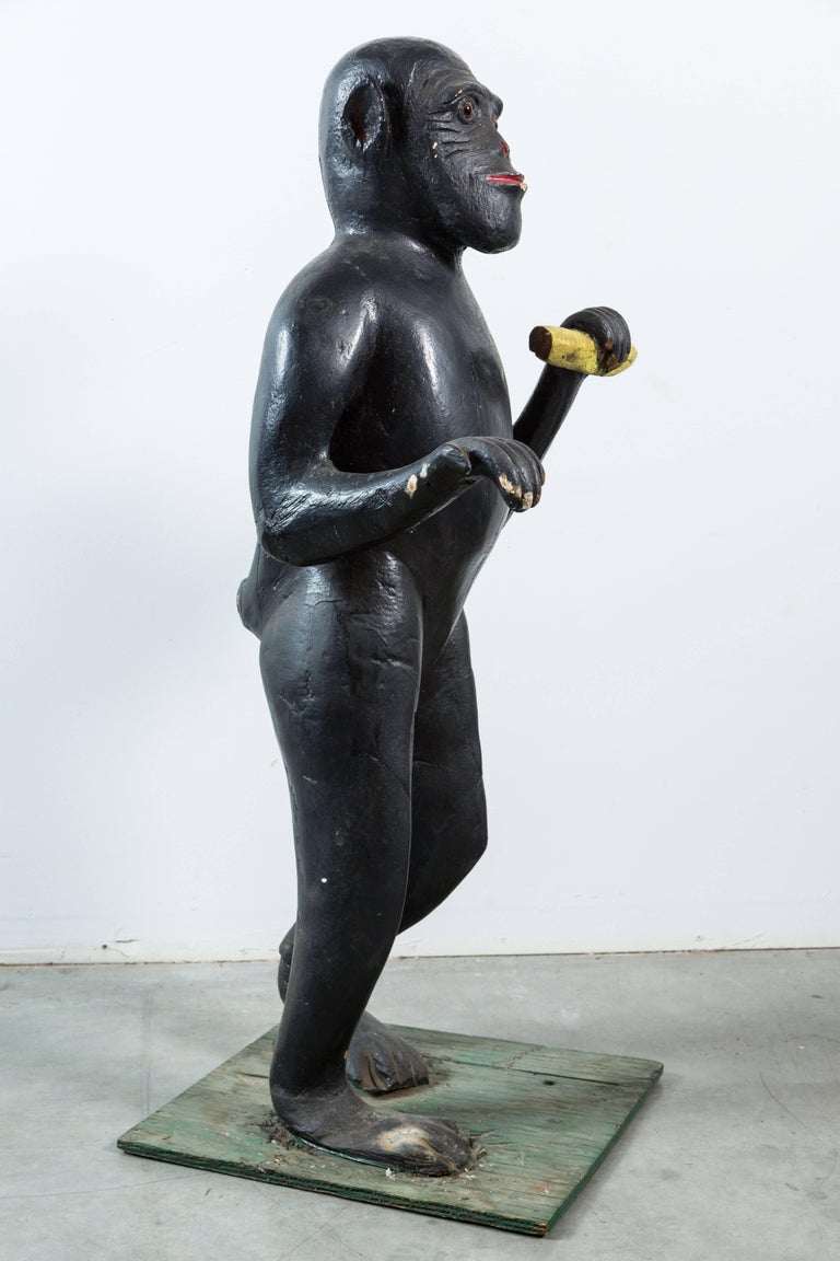 Mid-20th Century Vintage Life-Sized Folk Art Wood Monkey and Banana Carving with Glass Eyes For Sale