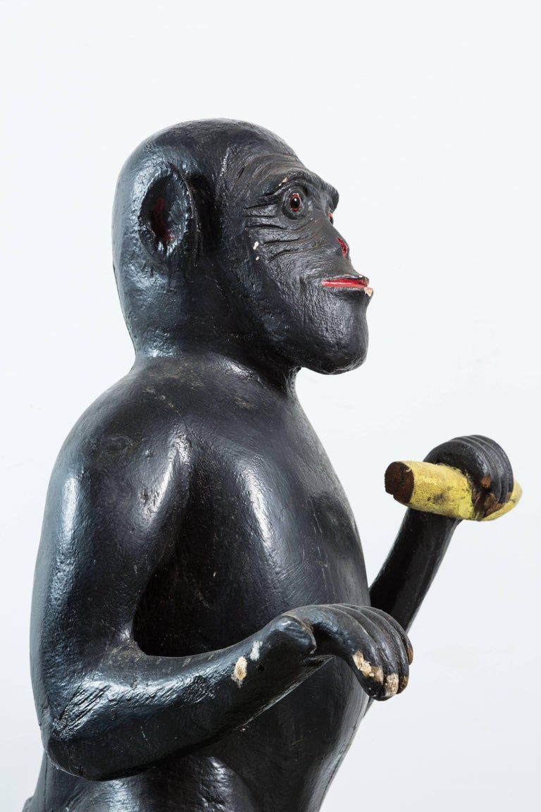 Vintage Life-Sized Folk Art Wood Monkey and Banana Carving with Glass Eyes For Sale 1
