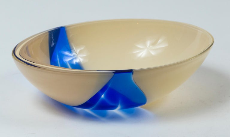 Vintage Livio Seguso Sculptural Glass Bowl, Murano, Italy, circa 1970. A teardrop shape bowl of creamy-white opaque and clear cobalt blue hand-blown glass.