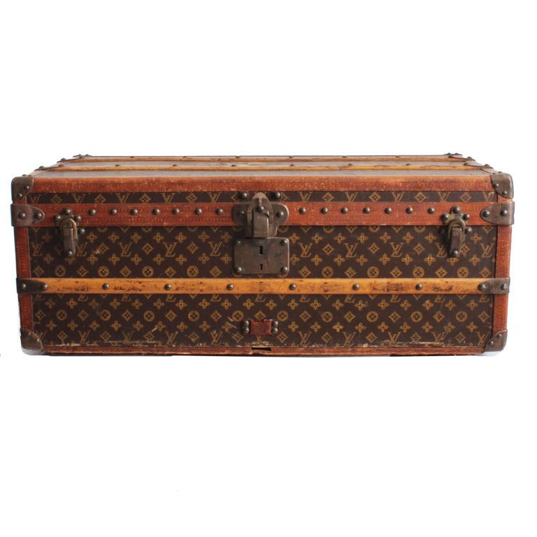 Vintage Louis Vuitton Cabin Trunk with Insert, circa 1961.  Made from monogram canvas, leather LV stamped trim; lined in fabric; wheels on bottom.  A great example of Louis Vuitton's craftsmanship & while designed for travel, makes a fabulous piece