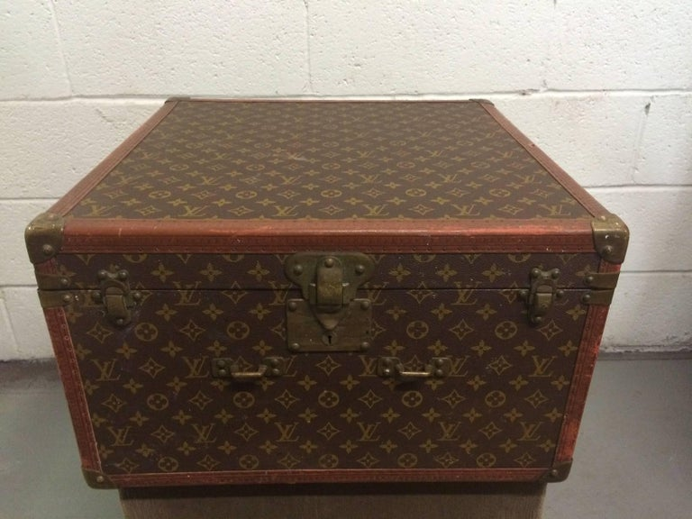 Vintage Louis Vuitton trunk / hat box. Has a silk interior with four corner pockets. Monogrammed on canvas with leather and brass hardware.