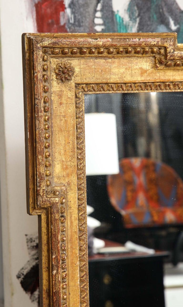 A vintage Louis XVI style giltwood mirror.