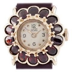 Vintage Lucien Piccard 14 Karat Gold and Garnet Flower Bezel Mechanical Watch