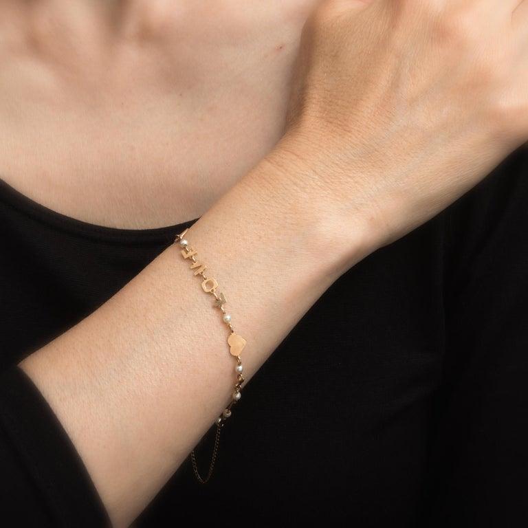 Modern Vintage Lucien Piccard i Love You Bracelet 14 Karat Gold Pearl Estate Jewelry For Sale
