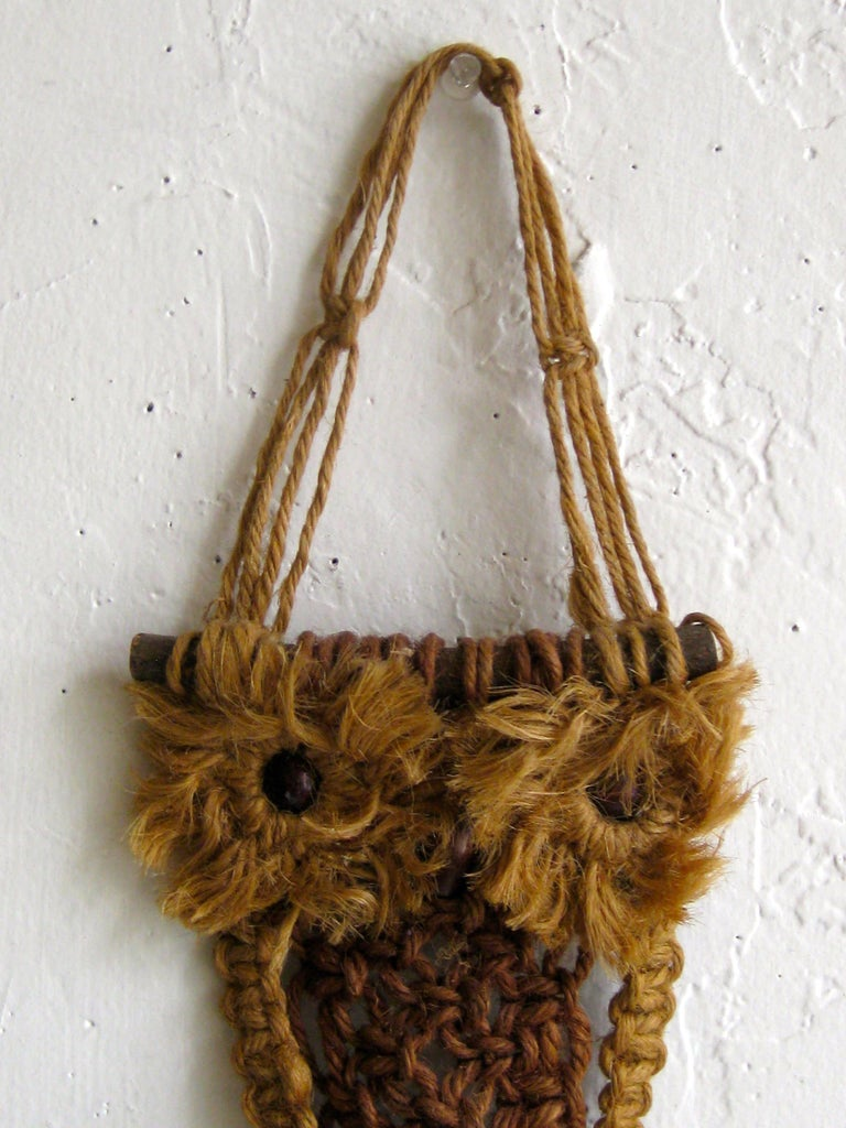 Vintage handmade macramé fiber art figural owl wall hanging sculpture. Has two hooks to hang up towels or keys. Great shape or design. In excellent condition. Measures 15 1/2