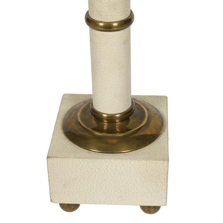 Vintage Maison Charles ivory palm motif lamp with brass details, square base sits on four round brass feet. Measures 26