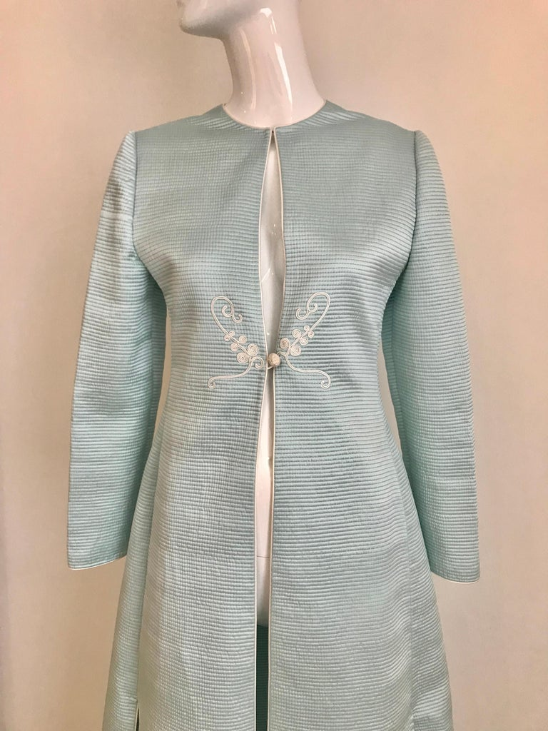 Vintage Mary McFadden light blue quilted silk coat with frogs closure . Slim fitting. Size: fit US 4 or 6
