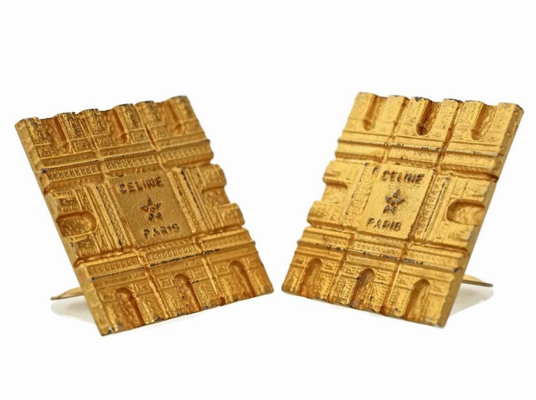 Vintage Massive CELINE PARIS Arc De Triomphe Iconic Earrings  Measurements: Height: 1 4/8 inches Width: 1 4/8 inches  Features: - 100% Authentic CELINE PARIS. - Massive square earrings with Arc de Triomphe on all sides. - Embossed CELINE PARIS at