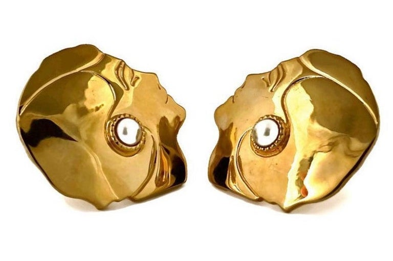 Vintage Massive CHANEL Mademoiselle Profile Earrings  Measurements: Height: 1 6/8 inches Width: 1 6/8 inches  Features: - 100% Authentic CHANEL. - Massive earrings in profile of Mademoiselle Chanel wearing a pearl earring. - Gold tone. - Signed