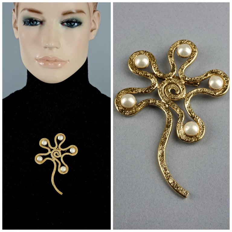 Vintage Massive CHANEL Spiral Flower Pearl Brooch  Measurements: Height: 4.33 inches (11 cm) Width: 2.75 inches (7 cm)  Features: - 100% Authentic CHANEL. - Massive textured gilt flower brooch with spiral motif. - Adorned with glass pearls. - Signed