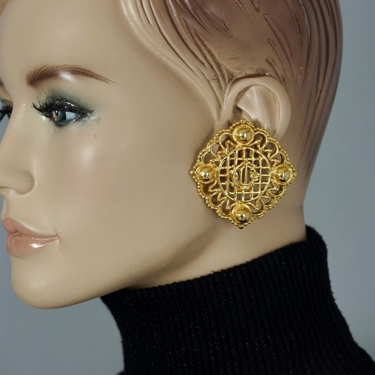 Vintage Massive CHRISTIAN DIOR Logo Insignia Mesh Earrings  MEASUREMENTS: Height: 2.12 inches (5.4 cm)  Width: 2.12 inches (5.4 cm)  Weight per Earring: 26 grams  FEATURES: - 100% Authentic CHRISTIAN DIOR. - Dior insignia/ logo centerpiece. - Mesh