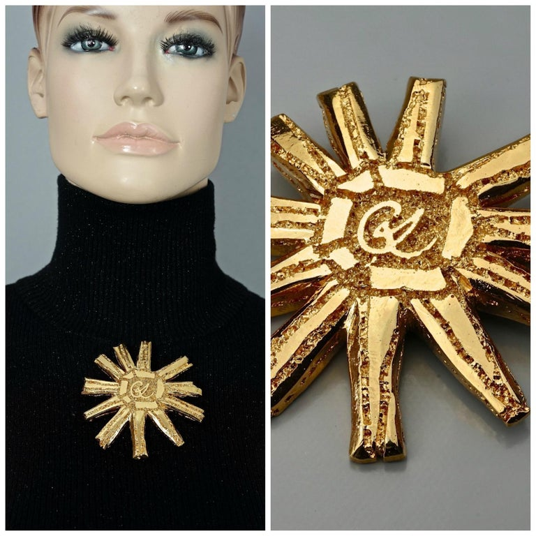 Vintage Massive CHRISTIAN LACROIX Logo Sun Brooch  Measurements: Height: 3.15 inches (8 cm) Width: 3.15 inches (8 cm)  Features: - 100% Authentic CHRISTIAN LACROIX. - Huge lightweight sun brooch. - CL logo at the center. - Gold tone. - Signed