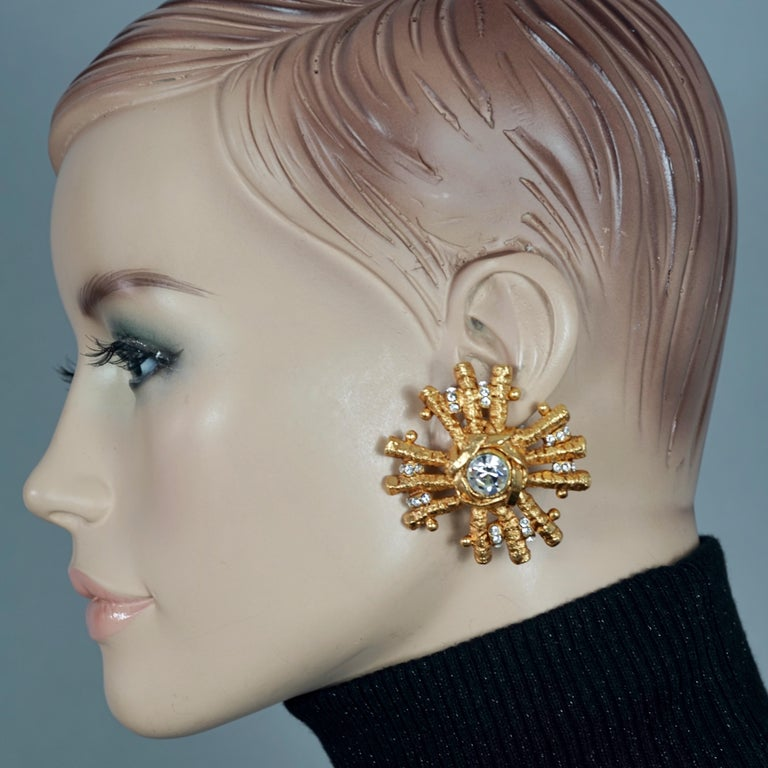 Vintage Massive CHRISTIAN LACROIX Sunburst Rhinestone Earrings  Measurements: Height: 2.05 inches (5.2 cm) Width: 1.97 inches (5 cm) Weight per Earring: 26 grams  Features: - 100% Authentic CHRISTIAN LACROIX. - Massive sunburst earrings with