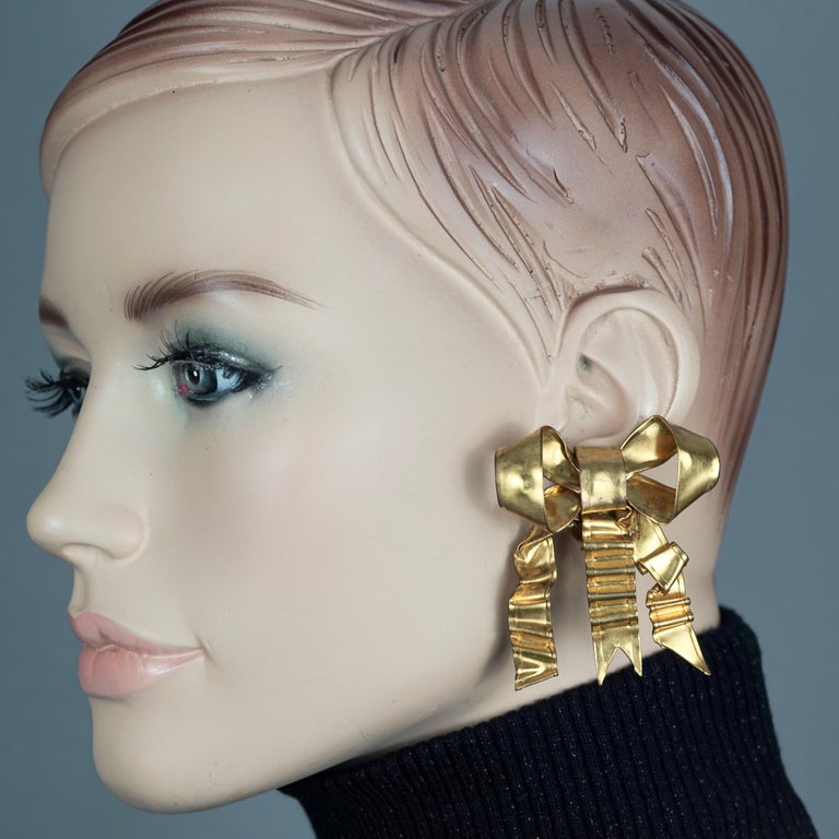 Vintage Massive PATRICK RETIF French Ribbon Earrings  Measurements:  Height: 2.16 inches (5.5 cm) Width: 1.97 inches (5 cm) Weight per Earring: 10 grams  Features: - 100% Authentic PATRICK RETIF. - Massive French ribbon/ bow earrings. - Gold and