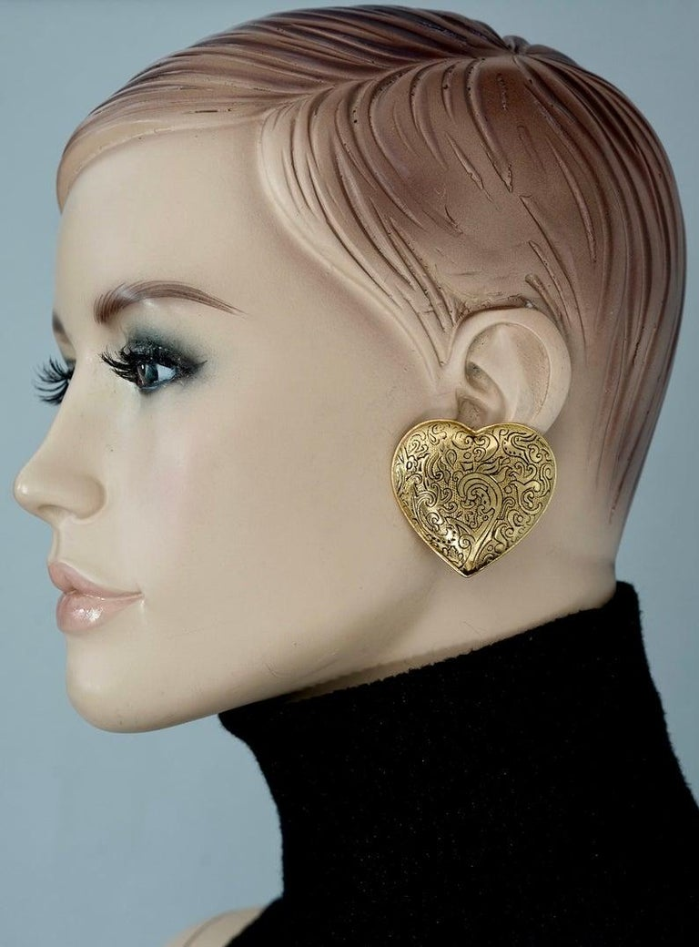 Vintage Massive YVES SAINT LAURENT Ysl Arabesque Heart Earrings  Measurements: Height: 1.65 inches (4.2 cm) Width: 1.73 inches (4.4 cm) Weight: 18 grams  Features: - 100% Authentic YVES SAINT LAURENT. - Massive heart in Arabesque pattern. - Gold