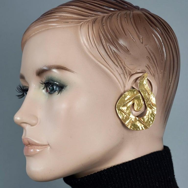 Vintage Massive YVES SAINT LAURENT Ysl Asymmetric Wrinkled Spiral Earrings  Measurements: 1st Earring Height: 2.32 inches (5.9 cm) 1st Earring Width: 1.69 inches (4.3 cm) 1st Earring Weight: 19 grams 2nd Earring Height: 2.28 inches (5.8 cm) 2nd