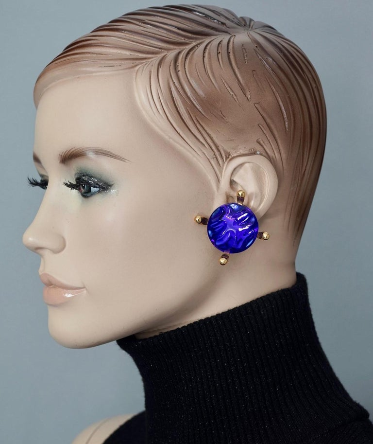 Vintage Massive YVES SAINT LAURENT Ysl Blue Glass Cabochon Earrings  Measurements: Height: 1.81 inches (4.6 cm) Width: 1.81 inches (4.6 cm) Weight per Earring: 23 grams  Features: - 100% Authentic YVES SAINT LAURENT. - Irregular blue glass cabochon