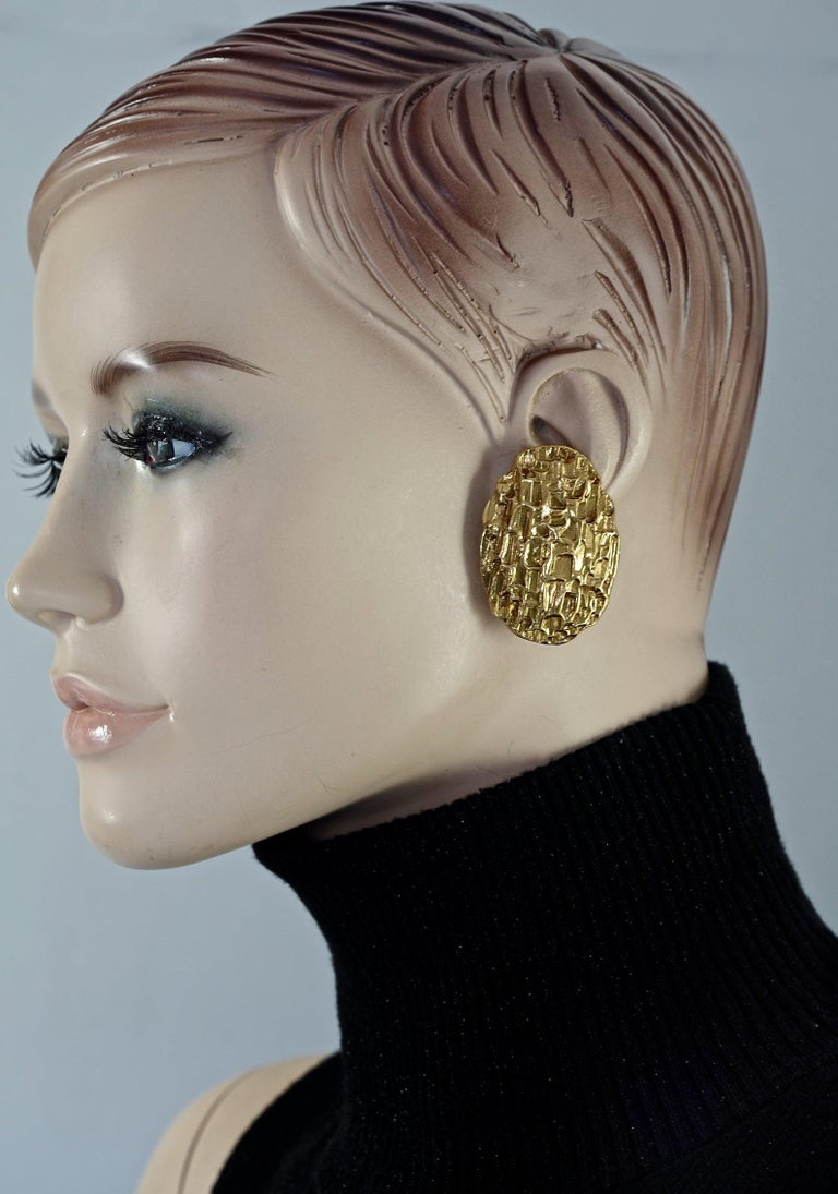 Vintage Massive YVES SAINT LAURENT Ysl by Robert Goossens Textured Earrings  Measurements: Height: 1.77 inches (4.5 cm) Width: 1.25 inches (3.2 cm) Weight per Earring: 17 grams  Features: - 100% Authentic YVES SAINT LAURENT by Robert Goossens. -