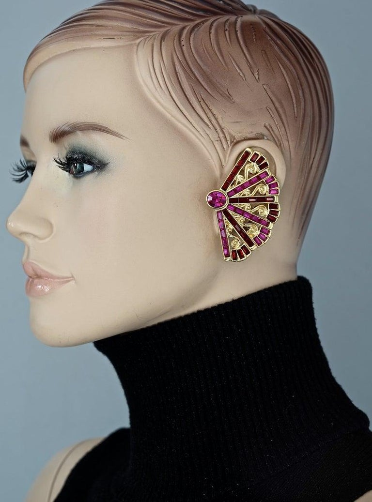 Vintage Massive YVES SAINT LAURENT Ysl Fan Rhinestone Earrings  Measurements: Height: 2.20 inches (5.6 cm) Width: 1.69 inches (4.3 cm) Weight per Earring: 29 grams  Features: - 100% Authentic YVES SAINT LAURENT. - Massive fan earrings with faceted