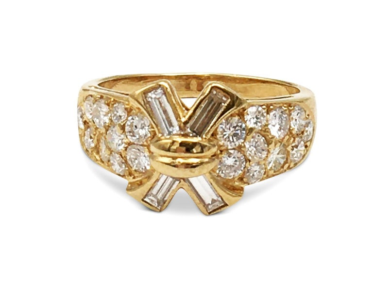 Authentic Mauboussin ring made in 18 karat yellow gold featuring 20 round cut diamonds weighing approximately .07ct each and 4 emerald cut diamonds weighing approximately .16ct each. Size 8.  Mauboussin stamp is faint and partially rubbed, but