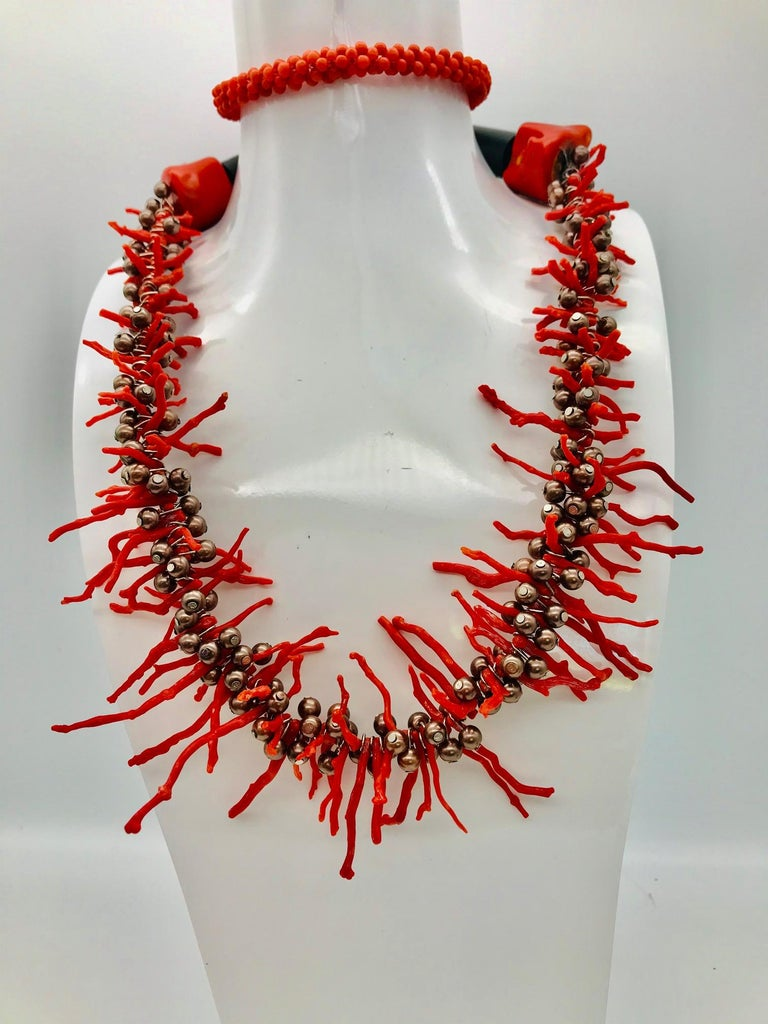 Vintage Mediterranean Red Branch Coral and Brown Pearls  Necklace.The Coral necklace has been up-cycled from a small necklace I was gifted  as a  teenager. I have made it longer by adding another smaller coral beed necklace on the back ,tiny Brown