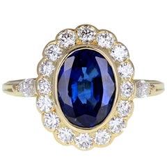 Vintage Mellerio 18 Carat Gold Oval Blue Sapphire Diamond Cluster Ring