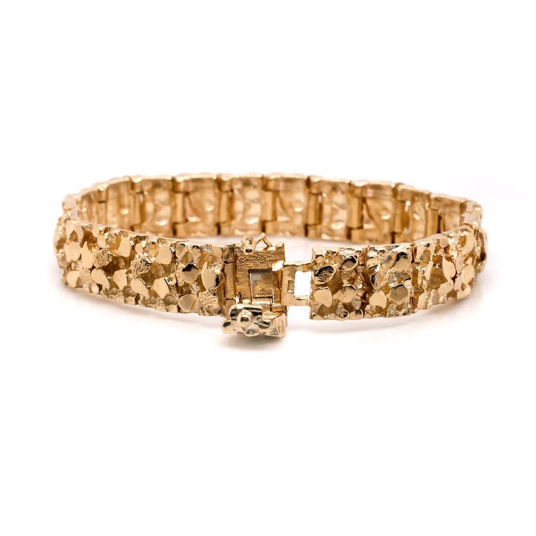 This Bold Vintage 14 Karat Yellow Gold Nugget Bracelet is the greatest statement piece. It is in twenty-three (23) gold nugget link segments allowing for flexibility and comfort all the way around. Measuring 7'' but  can be sized down in size prior