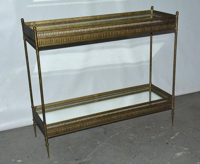 The vintage Regency style console have two mirrored gallery tray siding. The mottled metal