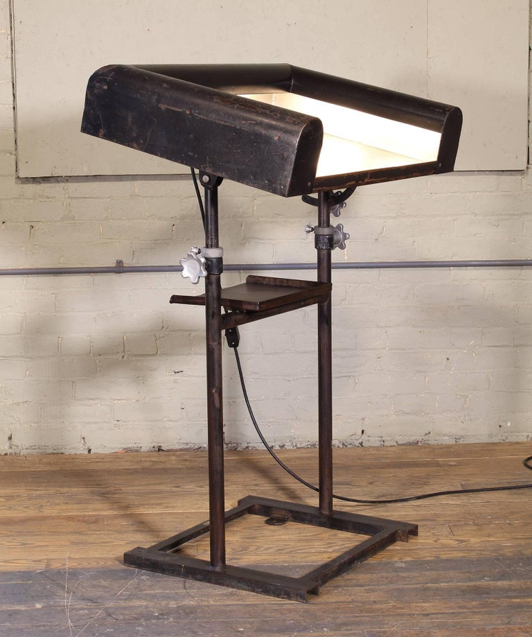 "Vintage art deco modern style metal lighted lectern, podium, pedestal stand. Fixed height. Inline switch for lights. Overall dimensions measure 31 1/2"" in width, 23"" in depth and 47"" in height."