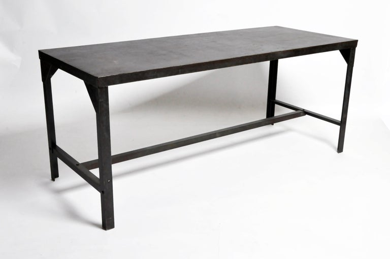 This impressive industrial welder's metal table is from France and was made circa 1960. Much of the original paint has been retained but the top has been cleaned and a sealer applied.