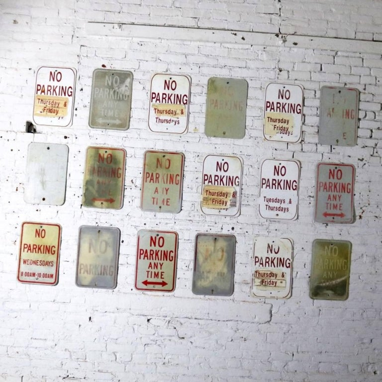 We are offering 18 vintage metal no parking signs in varying degrees of condition and patina. In the photos some signs look like there is no printing on them. It is there but very faded. We would not suggest these as a single purchase, but they do