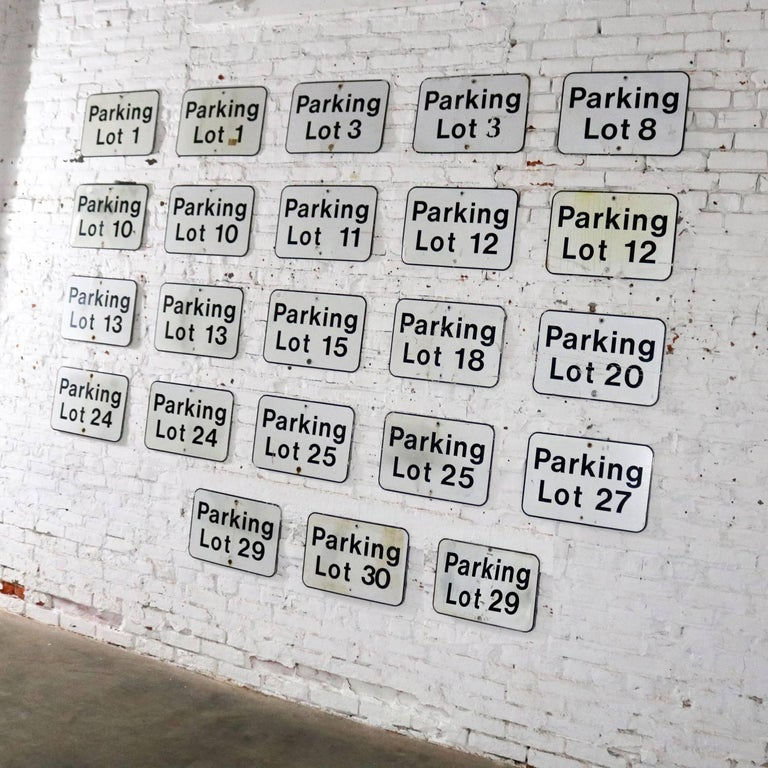 We are offering here 23 vintage metal parking lot number signs. They are in differing degrees of condition and patina but all wonderful. We have priced them per sign but will sell all 23 for $1900.00 or will give group pricing if desired, circa 20th