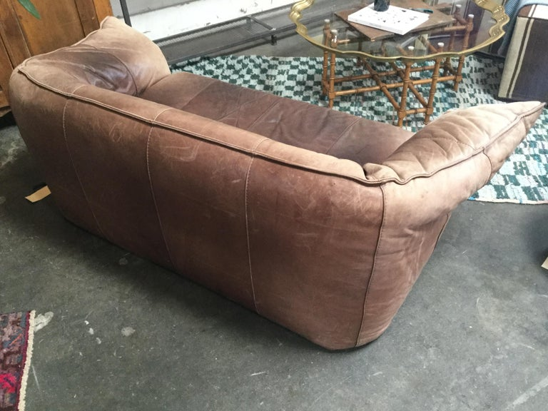 French 1960s leather Michel Ducaroy styled handmade sofa. With a rich mocha color and aged leather. Styled in the idea of 1960s lounge.