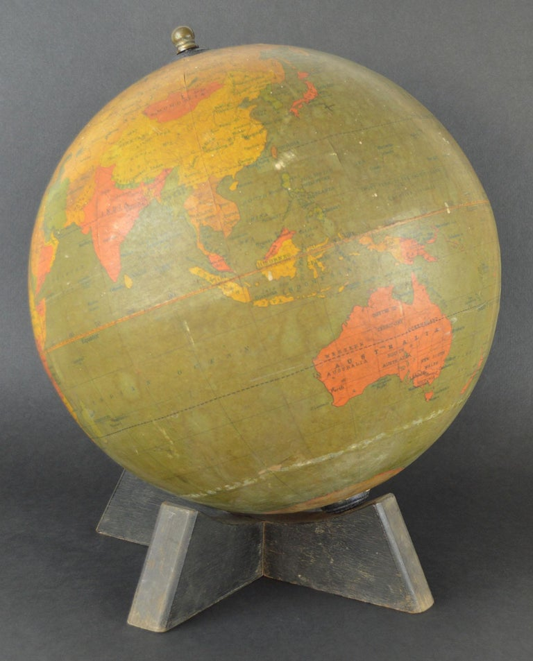 Fabulous 12 inch globe  I particularly like the simplicity of the piece and the amazing colour  Slightly distressed.  By W.A.K. Johnston and G.W. Bacon.
