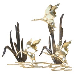 Vintage mid century brass Hollywood Regency wall decoration with 3 flying geese