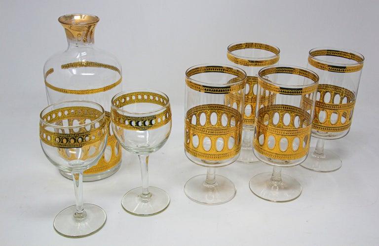 "Elegant vintage cocktail set of midcentury culver Antigua barware glasses with 22-karat gold leaf design. Signed culver. Midcentury ""Antigua"" pattern. Great addition to any bar set or serving set. Very good condition. Measures:  4 cocktail"