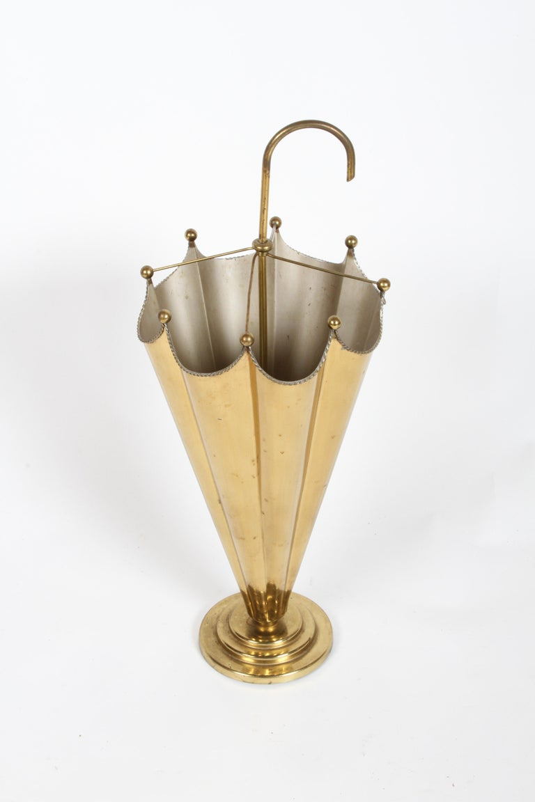 Vintage Italian brass umbrella or cane stand with twisted brass rope edge and brass balls. Light patina, few minor dings. Very well made, weighted base.