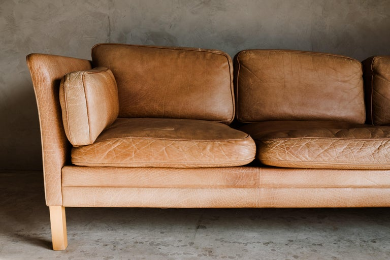 Vintage midcentury leather sofa from Denmark, circa 1970. Original cognac leather upholstery with fantastic color and patina.