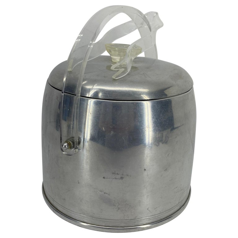 Vintage aluminum ice bucket and Lucite tongs.