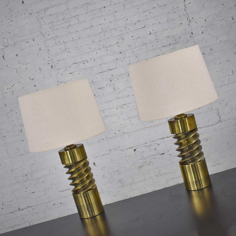 Awesome Mid-Century Modern brass plated corkscrew style table lamps with new off-white shades. Beautiful vintage condition with gorgeous patina that only time creates with age and wear. Please see photos. Circa mid century.  Come on BABY…Let's do