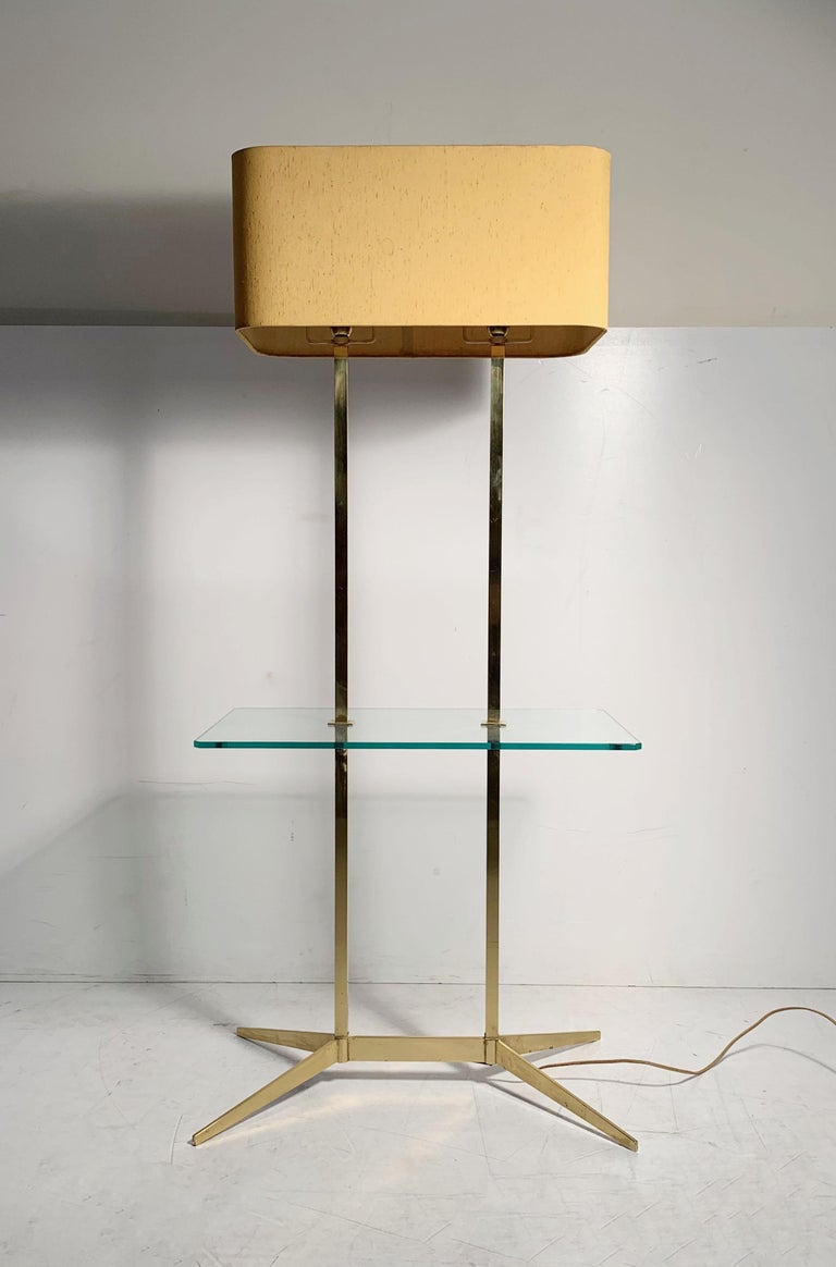 Vintage Mid-Century Modern brass table floor lamp. In the manner of Paul McCobb, Gerald Thurston and Arredoluce. I believe the lamp is manufactured by Stiffel. Glass table top was specially cut to match the wood top that had originally come with it.