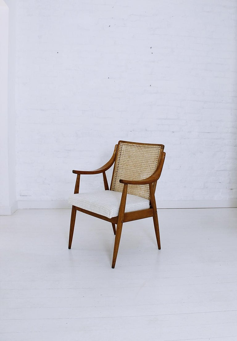Rare Mid-Century Modern Hungarian armchair in style of Peter Hvidt and Orla Mølgaard-Nielsen, in very good condition. This chair in beechwood with double caned back is newly upholstered.