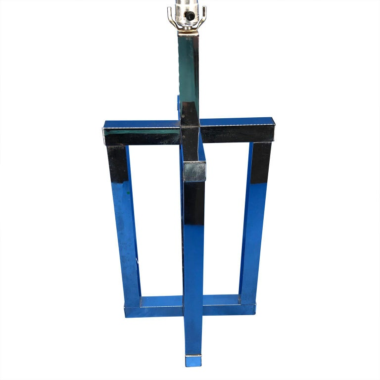 Mid-Century Modern chrome geometric shaped table lamp. Lamp is newly re-wired. This lamp is all chrome, the blue mirror-image you see in the mages should be disregarded.