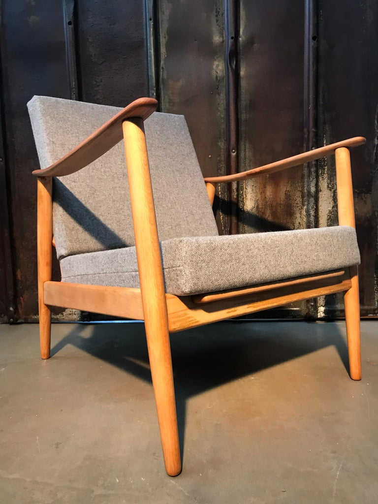 Vintage Danish Mid-Century Modern easy lounge chair in beech wood.  This chair has been totally refurbished and with new foam and covers in 100% New Zealand lambs wool. The beech wood has had all the old dark varnish removed by sanding and been