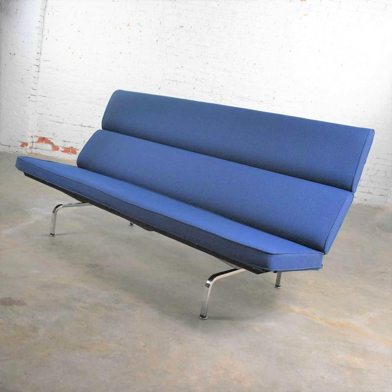 Handsome blue Mid-Century Modern sofa compact designed by Charles and Ray Eames for Herman Miller. It is in wonderful original vintage condition. We have not found any outstanding flaws only normal wear for age. There is a small spot on the back