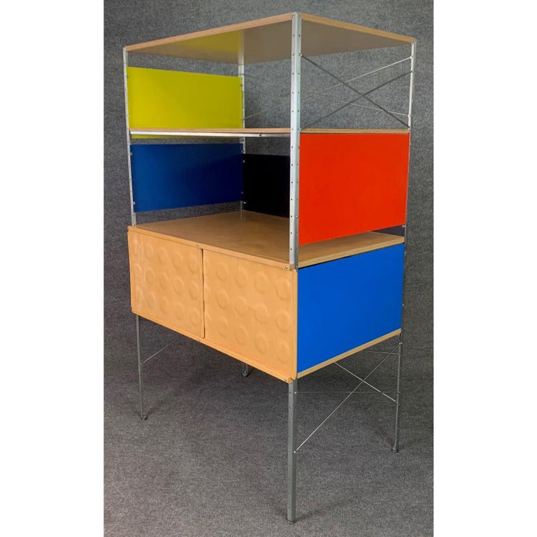 Here is a beautiful custom storage system inspired by the ESU units of Charles Eames manufactured by Modernica in the USA in the early 2000s. This colorful piece features a storage cubby behind two sliding doors and two shelving spaces. Very good
